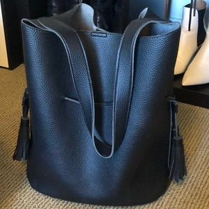 Large black bucket bag with tighten fringe